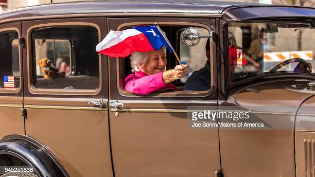 Austin Texas senior woman flies Texas flag down Congress Avenue for the annual Texas Independence Day parade to the Texas Capitol An official state...
