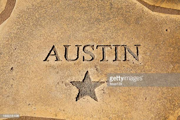 austin, texas shown on map of concrete. star, state capitol. - austin texas stock pictures, royalty-free photos & images