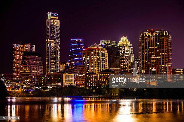 Austin, Texas skyline cityscape skyscrapers over Ladybird Lake at night