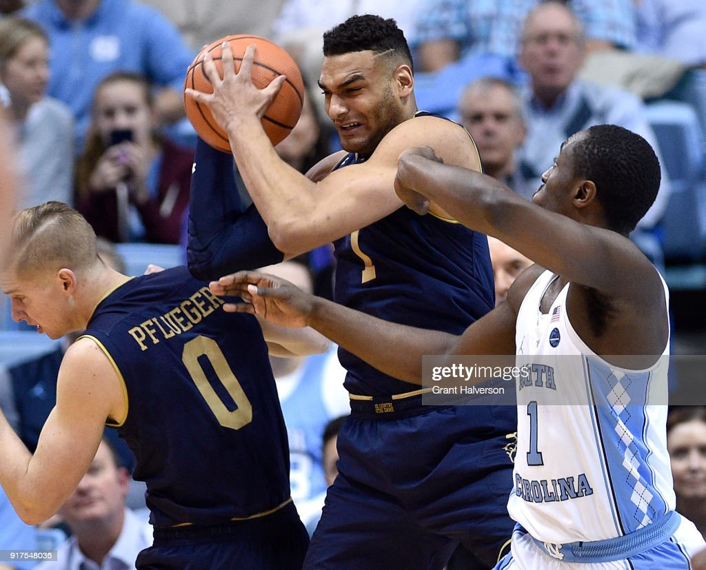 Austin Torres #1 of the Notre Dame Fighting Irish battles Theo Pinson #1 of the North Carolina Tar Heels for a rebound during their game at the Dean Smith Center on February 12, 2018 in Chapel Hill, North Carolina.