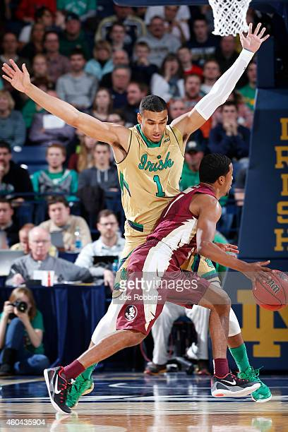 Austin Torres of the Notre Dame Fighting Irish defends against Devon Bookert of the Florida State Seminoles during the game at Purcell Pavilion on...