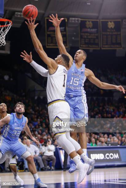 Austin Torres of the Notre Dame Fighting Irish shoots the ball against Garrison Brooks of the North Carolina Tar Heels at Purcell Pavilion on January...