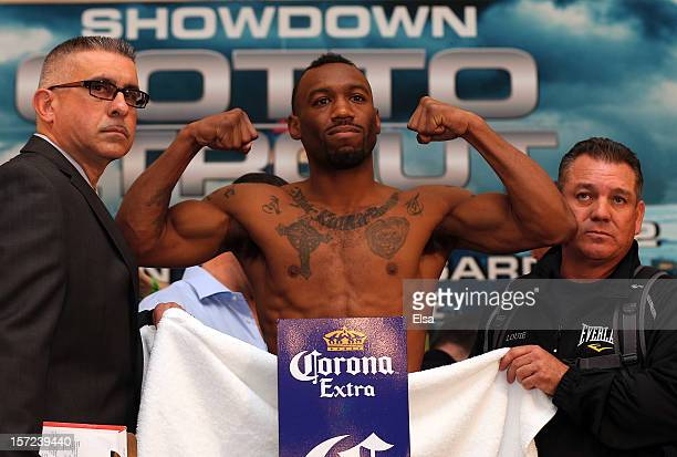 Austin Trout poes after having to strip down to make the weight during the weigh in before the fight for Trout's Super Welterweight Title against...