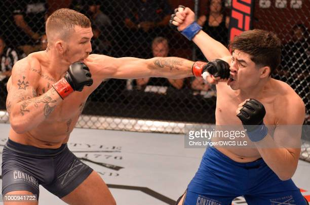 Austin Vanderford punches Angelo Trevino in their welterweight fight during Dana White's Tuesday Night Contender Series at the TUF Gym on July 17...