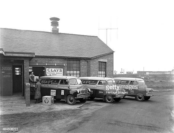 Austin vans being loaded outside Clays TV repair depot Mexborough South Yorkshire 1959