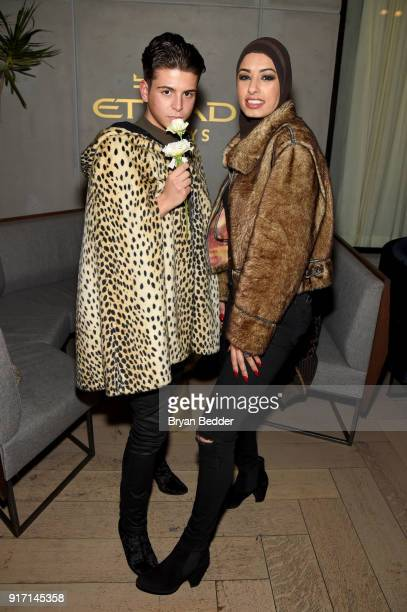 Austin Velarde and Eman B Fendi relaxes in the Etihad Airways VIP Lounge at NYFW The Shows on February 11 2018 in New York City