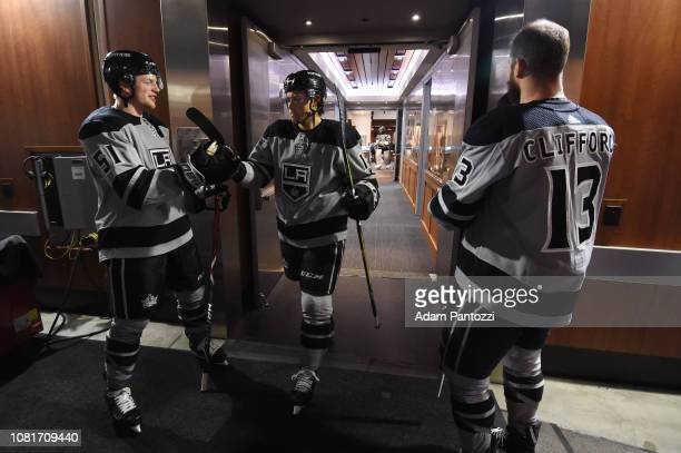 Austin Wagner and Alex Iafallo of the Los Angeles Kings highfive as Iafallo leaves the locker room for warmup and Kyle Clifford looks on before the...