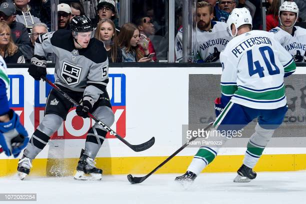 Austin Wagner of the Los Angeles Kings and Elias Pettersson of the Vancouver Canucks battle for the puck during the second period of the game at...