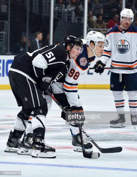 Austin Wagner of the Los Angeles Kings and Jesse Puljujarvi of the Edmonton Oilers battle for position while waiting for play to begin during the...
