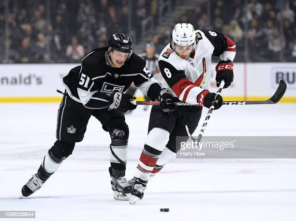Austin Wagner of the Los Angeles Kings and Nick Schmaltz of the Arizona Coyotes skate after the puck during the first period at Staples Center on...
