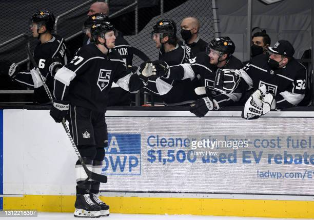 Austin Wagner of the Los Angeles Kings celebrates his goal with Sean Walker and Jonathan Quick, to take a 1-0 lead over the Vegas Golden Knights,...