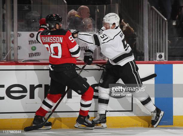Austin Wagner of the Los Angeles Kings checks Marcus Johansson of the New Jersey Devils during the second period at the Prudential Center on February...