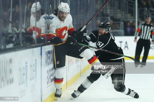 Austin Wagner of the Los Angeles Kings checks Rasmus Andersson of the Calgary Flames during the first period at Staples Center on April 01 2019 in...
