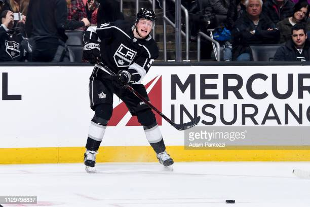 Austin Wagner of the Los Angeles Kings passes the puck during the third period of the game at STAPLES Center on February 14 2019 in Los Angeles...