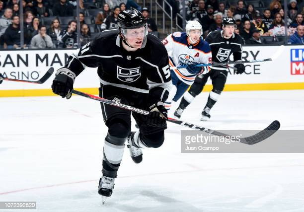 Austin Wagner of the Los Angeles Kings races for the puck during the third period of the game at STAPLES Center on November 25 2018 in Los Angeles...