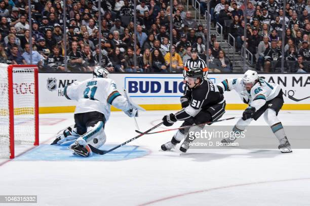 Austin Wagner of the Los Angeles Kings shoots the puck against Martin Jones and Erik Karlsson of the San Jose Sharks at STAPLES Center on October 5...