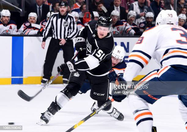 Austin Wagner of the Los Angeles Kings shoots the puck with pressure from Drake Caggiula of the Edmonton Oilers during the first period of the game...