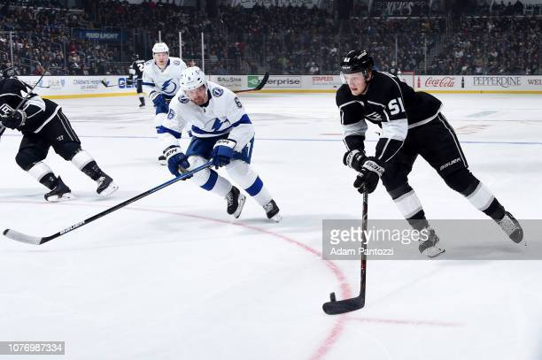Austin Wagner of the Los Angeles Kings skates with the puck with pressure from Anton Stralman of the Tampa Bay Lightning during the first period of...