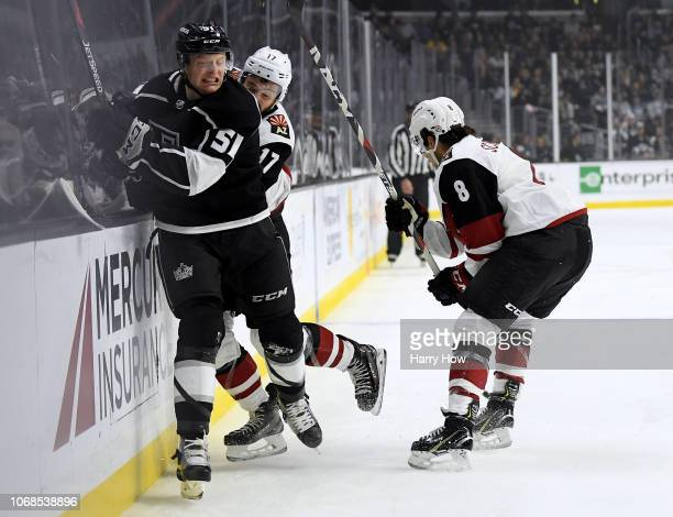 Austin Wagner of the Los Angeles Kings takes a hit from Alex Galchenyuk of the Arizona Coyotes during the first period at Staples Center on December...