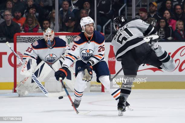 Austin Wagner of the Los Angeles Kings takes a slapshot as Darnell Nurse and goaltender Cam Talbot of the Edmonton Oilers defend during the second...