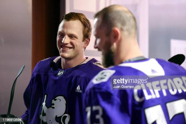 Austin Wagner of the Los Angeles Kings talks with Kyle Clifford prior to Wagneru2019s 100th NHL game before warm ups against the Philadelphia Flyers...