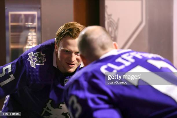 Austin Wagner of the Los Angeles Kings walks with Kyle Clifford prior to Wagners 100th NHL game before warm ups against the Philadelphia Flyers at...
