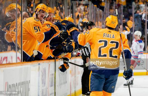 Austin Watson congratulates Kevin Fiala of the Nashville Predators on his goal against the New York Rangers at Bridgestone Arena on December 29 2018...