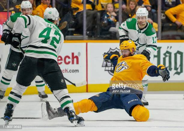 Austin Watson of the Nashville Predators attempts to block a pass against Taylor Fedun of the Dallas Stars in Game Two of the Western Conference...