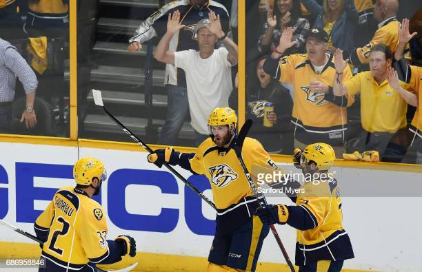 Austin Watson of the Nashville Predators celebrates his goal against the Anaheim Ducks with teammates during the first period in Game Six of the...