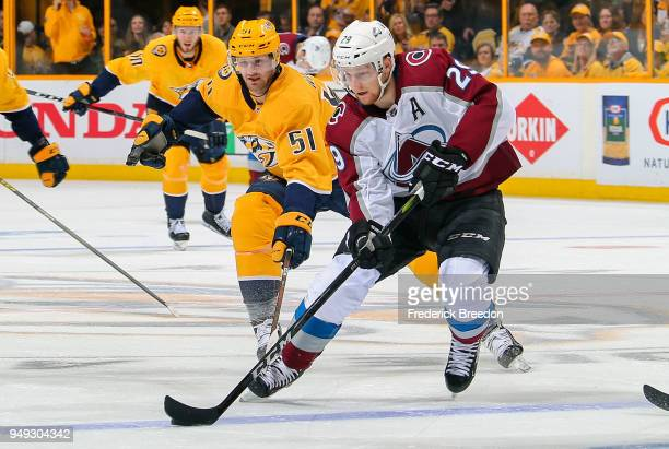 Austin Watson of the Nashville Predators chases Nathan MacKinnon of the Colorado Avalanche during the second period in Game Five of the Western...