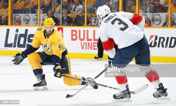 Austin Watson of the Nashville Predators defends against Keith Yandle of the Florida Panthers during an NHL game at Bridgestone Arena on January 20...