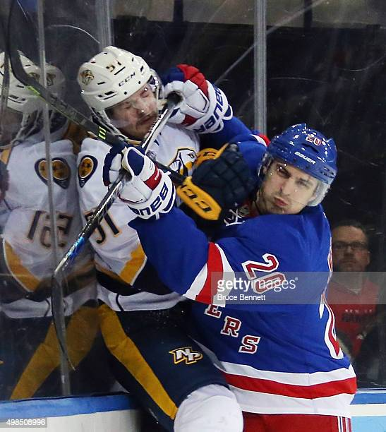 Austin Watson of the Nashville Predators is checked into the boards by Chris Kreider of the New York Rangers during the second period at Madison...