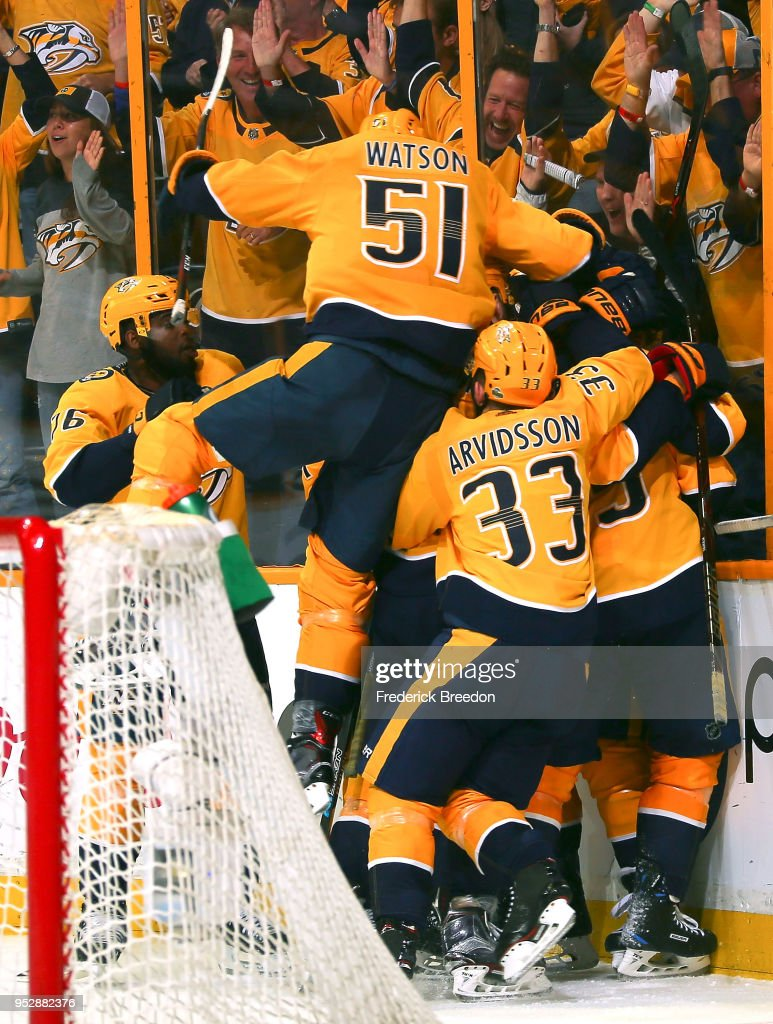 Austin Watson #51 of the Nashville Predators jumps on top of teammate Viktor Arvidsson #33 and other teammates after defeating the Winnipeg Jets during the second period of overtime in Game Two of the Western Conference Second Round during the 2018 NHL Stanley Cup Playoffs at Bridgestone Arena on April 29, 2018 in Nashville, Tennessee.