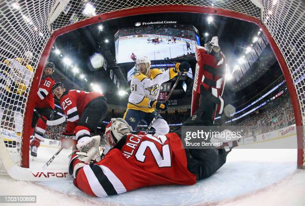 Austin Watson of the Nashville Predators moves in on Mackenzie Blackwood of the New Jersey Devils during the second period at the Prudential Center...