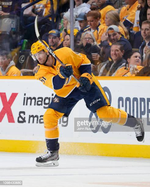 Austin Watson of the Nashville Predators passes the puck against the Florida Panthers at Bridgestone Arena on January 19 2019 in Nashville Tennessee