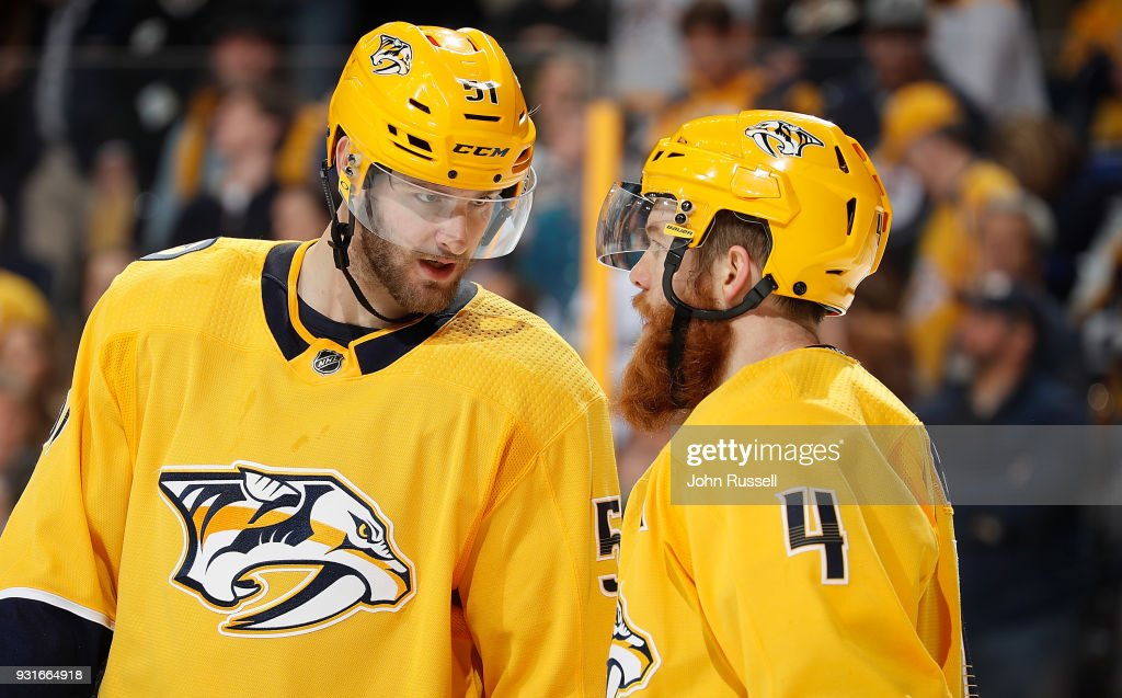 Austin Watson #51 talks with Ryan Ellis #4 of the Nashville Predators before play begins against the Winnipeg Jets during an NHL game at Bridgestone Arena on March 13, 2018 in Nashville, Tennessee.