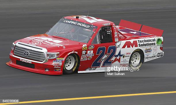 Austin Wayne Self driver of the AM Technical Solutions Toyota practices for the NASCAR Camping World Truck Series Buckle Up In Your Truck 225 at...