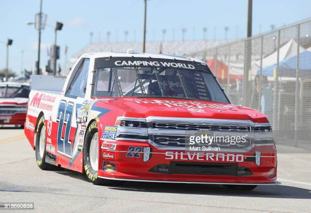 Austin Wayne Self driver of the DontMessWithTexas/AMTechSolutions Chev drives through the garage during practice for the NASCAR Camping World Truck...