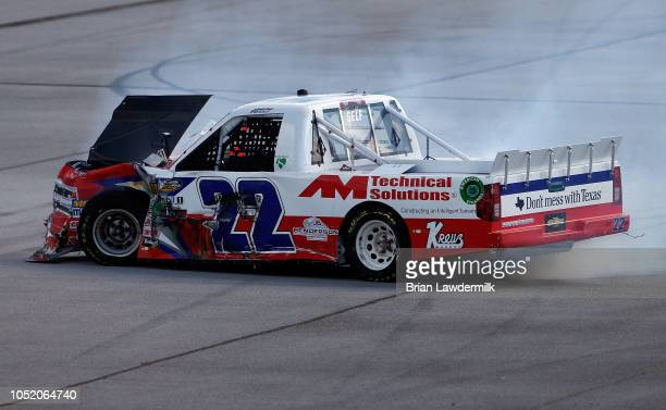 Austin Wayne Self driver of the GO TEXAN Chevrolet is involved in an ontrack incident during the NASCAR Camping World Truck Series Fr8Auctions 250 at...