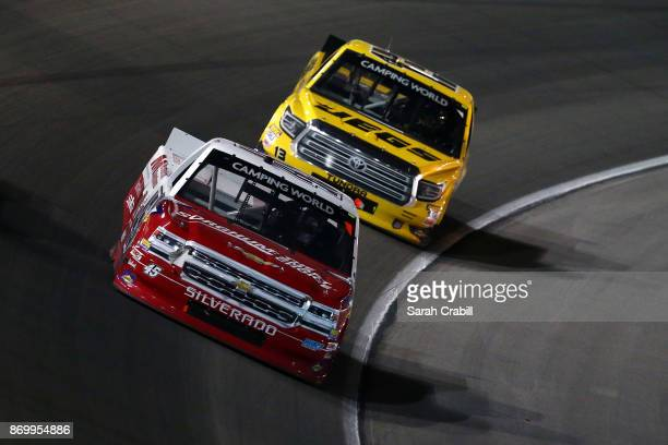 Austin Wayne Self driver of the Texas Grain Sorghum Board/AMTchnclSltns Chev leads Cody Coughlin driver of the JEGS Toyota during the NASCAR Camping...