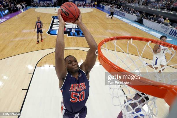 Austin Wiley of the Auburn Tigers dunks the ball against the Kansas Jayhawks in the first half of the Second Round of the NCAA Basketball Tournament...