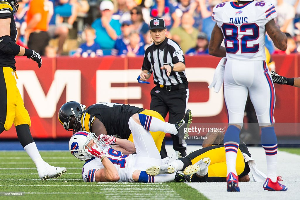 Austin Willis #19 of the Buffalo Bills reacts to being hit on a punt return before leaving the game during the second half of a preseason game on August 29, 2015 at Ralph Wilson Stadium in Orchard Park, New York. Buffalo defeats Pittsburgh 43-19.