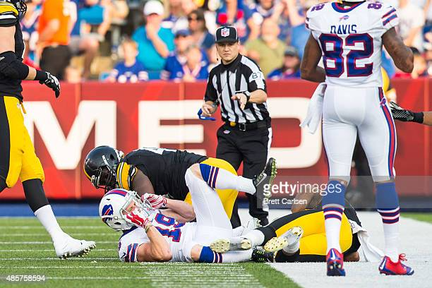 Austin Willis of the Buffalo Bills reacts to being hit on a punt return before leaving the game during the second half of a preseason game on August...