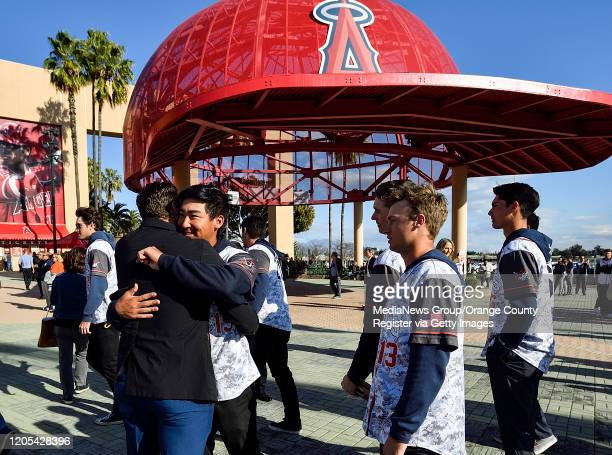 Austin Wobrock greets Orange Coast Baseball players as they arrive at a memorial service for the Altobelli family in Anaheim CA on Monday Feb 10 2020...