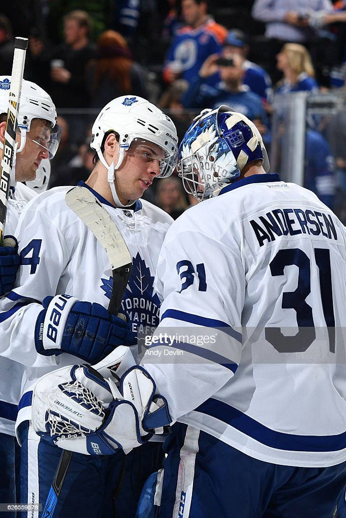 Auston Matthews #34 and Frederik Andersen #31 of the Toronto Maple Leafs celebrate after winning the game against the Edmonton Oilers on November 29, 2016 at Rogers Place in Edmonton, Alberta, Canada.