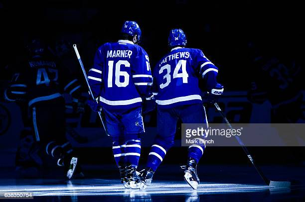 Auston Matthews and Mitch Marner of the Toronto Maple Leafs skate the pregame spotlight before playing the Montreal Canadiens at the Air Canada...