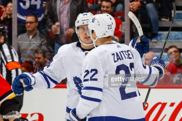 Auston Matthews and Nikita Zaitsev of the Toronto Maple Leafs celebrate in an NHL game against the Toronto Maple Leafs at the Scotiabank Saddledome...
