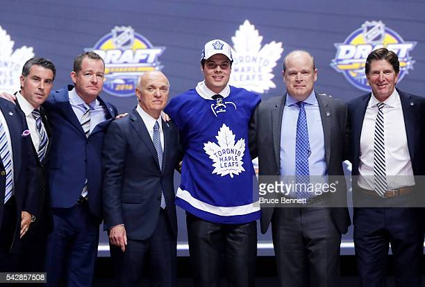 Auston Matthews celebrates onstage with the Toronto Maple Leafs after being selected first overall by the Toronto Maple Leafs during round one of the...