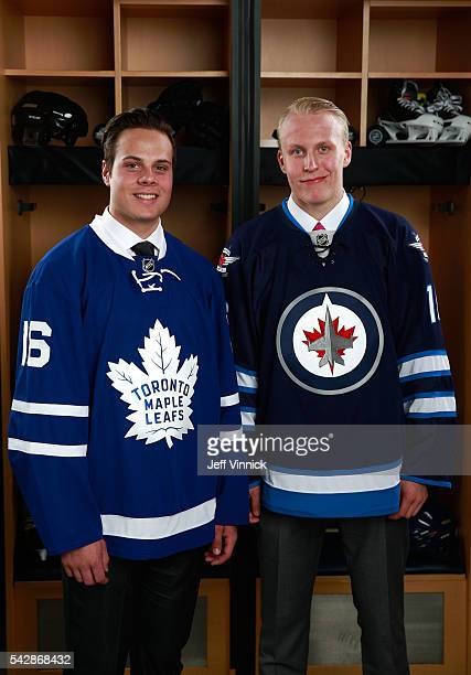 Auston Matthews left selected first overall by the Toronto Maple Leafs and Patrik Laine right selected second overall by the Winnipeg Jets pose for a...