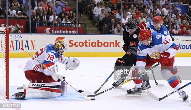 Auston Matthews of Team North America battles for a loose puck with Alexey Marchenko in front of Sergei Bobrovsky of Team Russia during the World Cup...